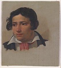 Portræt af en ung mand med rød halsklud