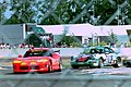 Dodge Viper RT10 - Rene Arnoux, Justin Bell & Bertrand Balas lead Porsche 964 Carrera RSR - Cor Euser, Matjaz Tomje & Patrick Huisman into Ford Chicane at the 1994 Le Mans (31822418592).jpg