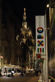 Vertical banner on a city street at night