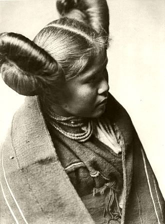 Tewa - Chaiwa, a Tewa girl with a butterfly whorl hairstyle, photographed by Edward S. Curtis in 1922