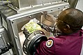 FDA scientist examines a lettuce sample in a sample preparation glove box.jpg