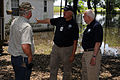 FEMA - 40997 - CR and PIO with Resident at flooded home.jpg