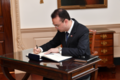 Filipino Foreign Affairs Secretary Cayetano Signs Secretary Pompeo's Guestbook (42892810802).png