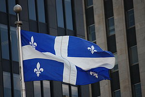 Flag of Quebec - A 1:2 Fleurdelisé flying in Downtown Montreal