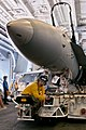 Flickr - Official U.S. Navy Imagery - Huntington Beach native-Sailor maneuvers an F-A-18C Hornet in the hangar bay of USS John C. Stennis.jpg
