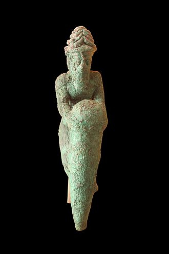 Gudea cylinders - Foundation figurine: kneeling god holding a nail. Copper, from Telloh, ancient Girsu.