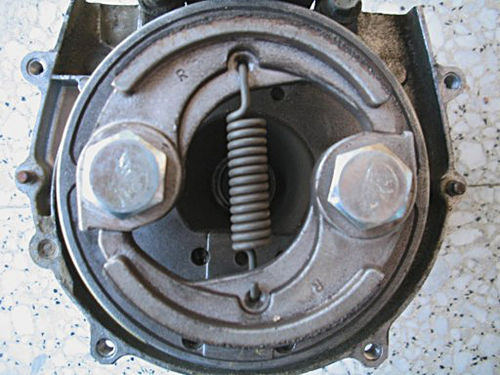 A two-shoe centrifugal clutch. The motor spins the input shaft that makes the shoes go around, and the outer drum (removed) turns the output power shaft.