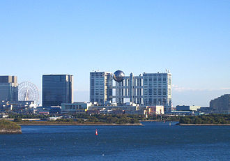 Odaiba - View of Odaiba from the north with Fuji TV building in the center, Daikanransha Ferris wheel to the left, shopping malls in the front, and Nikko hotel to the right