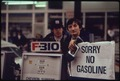 "GAS STATION ATTENDANTS PEER OVER THEIR ""OUT OF GAS"" SIGN IN PORTLAND, ON DAY BEFORE THE STATE'S REQUESTED SATURDAY... - NARA - 555434.tif"