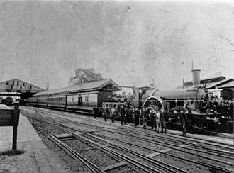 Taunton railway station - A westbound train in 1892 when part of the platform was covered by a roof