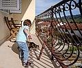 Gabriel feeds a cat, Stari Grad, Croatia (PPL1-Corrected) julesvernex2.jpg