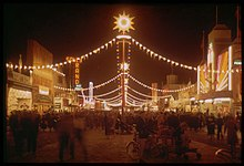 "The ""Gayway"" at the Golden Gate International Exhibition, photographed here at night in 1940 by Charles Cushman, hosted numerous sideshow-style attractions, including ""Sally Rand's Nude Ranch"" (neon sign, at left), a burlesque show."