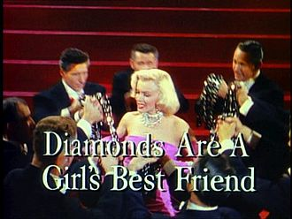 Diamonds Are a Girl's Best Friend - Monroe sings the song surrounded by well-dressed men.