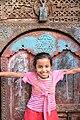 Girl and Door, Sana'a (14200917457).jpg