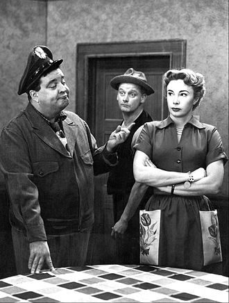 The Honeymooners - Ralph Kramden (Jackie Gleason) with Ed Norton (Art Carney), and Alice Kramden (Audrey Meadows) in a Honeymooners scene.