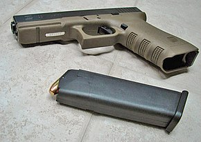 Glock 22 in the new Olive Drab frame (with magazine)