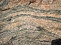 Gneiss (Archean; Windy Lake Northwest roadcut, Sudbury Impact Structure, Ontario, Canada) 5 (46946457454).jpg