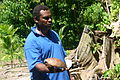 Godfrey Nassarie from Borohinaba village, Central Province holds a coconut to demonstrate the copra drying project. Solomon Islands 2004. Photo- Peter Davis - AusAID (10698226656).jpg