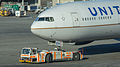 Goldhofer pushback tractor with a United Airlines plane at San Francisco International Airport-0725.jpg