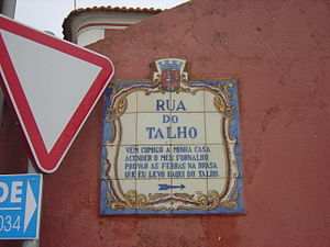 """Gouveia (Sintra) - A typical street sign in Gouveia carrying a stanza (in this case, the """"Butcher's street"""")."""