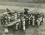 Group of women inspecting a small aircraft at an airport in South East Queensland (4461737044).jpg