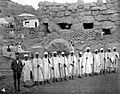 Guards outside House of Boulders, Jebel Moya site, Sudan Wellcome L0021184.jpg