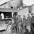 Gunners of 78th Field Regiment, Royal Artillery queuing at a NAAFI refreshment van in Italy, 22 November 1943. NA8953.jpg