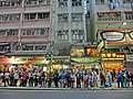 HK Wan Chai Road evening Bus stop visitors Mar-2014 Building facades.JPG