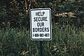 Help Secure Our Borders - U.S. Customs and Border Protection Phone Report Sign (27065816647).jpg