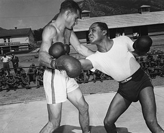 Henry Armstrong - Armstrong (right) demonstrating some boxing techniques to a US Army member during an exhibition tour in 1943.
