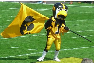 Iowa Hawkeyes - School mascot Herky the Hawk waves a flag at an Iowa football game on September 16, 2006.