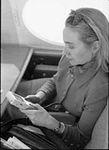Hillary Rodham Clinton on plane using Game Boy (06).jpg