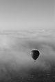 Hot air balloon rising through the clouds 2.jpg
