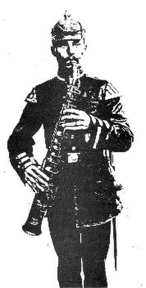 Heckelphone-clarinet - A musician playing a heckelphone-clarinet.