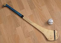 Hurling stick (hurley) and ball (sliotar) (Irish Camán agus sliotar)