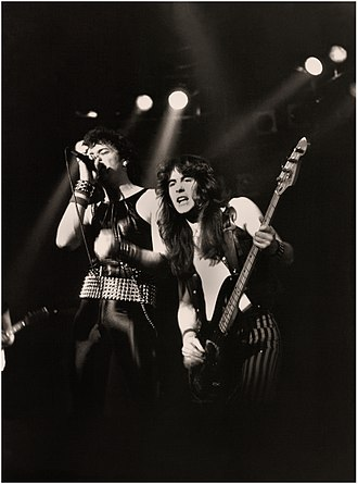 New wave of British heavy metal - Paul Di'Anno and Steve Harris of Iron Maiden. Di'Anno's appearance and personality made him look more like a punk singer than a metalhead.