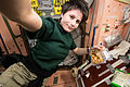 ISS-42 Samantha Cristoforetti prepares to eat a snack in the Unity node.jpg