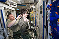 ISS-43 Samantha Cristoforetti and Terry Virts in the Tranquility module during haircut.jpg