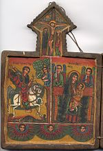 Icon shows St. George, the Crucifixion, and the Virgin Mary.