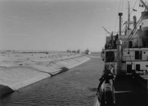 In the Suez Canal the convoy is waiting in the queue until the toward coming traffic has passed - 1957.png