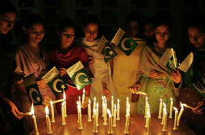 Independence Day (Pakistan) - Girls lighting candles at midnight to celebrate the day