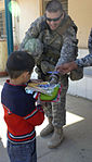 Iraqi Security Forces, Multi-National Division - Baghdad Soldiers distribute supplies to Karada schools DVIDS154466.jpg