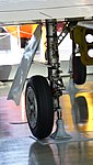 JASDF T-1A(15-5825) left main landing gear left rear view at Hamamatsu Air Base Publication Center November 24, 2014.jpg