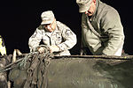 JBER airmen recover F-4 Fuel Tank from Port of Anchorage 120918-F-ZC102-182.jpg
