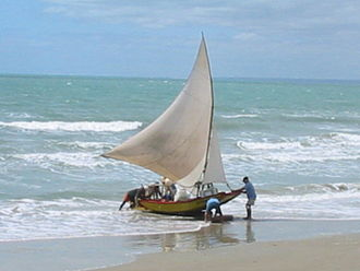 The Amazing Race 13 - For part of the Detour, teams traveled to Pecém Beach and rode a traditional Brazilian sailboat known as a Jangada.