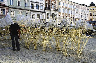 Jansen's linkage - Theo Jansen's kinetic sculpture Strandbeest. A wind-driven walking machine.