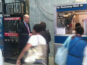 Jay Walder - Walder greets Hurricane Irene evacuees at the Far Rockaway – Mott Avenue subway station.