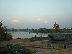 Quiet waterfront in Solapur, with a statue in the foreground