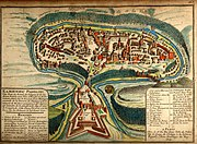 A 1691 French map of the city of Kamianets-Podilskyi, located in western Ukraine. The castle is situated on the top of a mountain surrounded by the Smotrycz River.