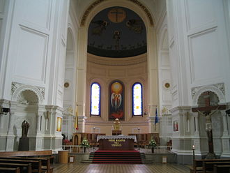 St. Michael the Archangel Church, Kaunas - Interior of the church with Lithuanian and Nato flags.